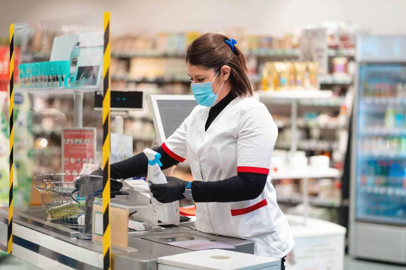 woman behind glass plexiglass checkout counter sneeze guard divider toronto